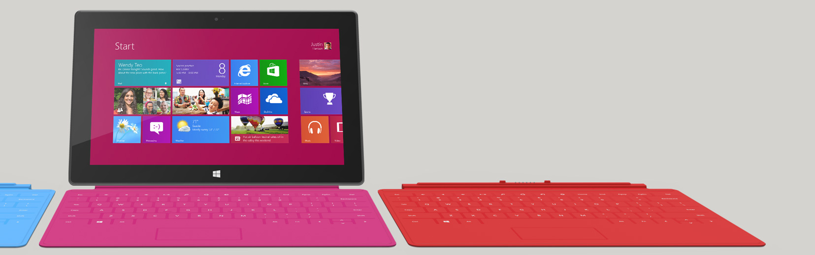 Picture of the Microsoft Surface with a magenta touch cover