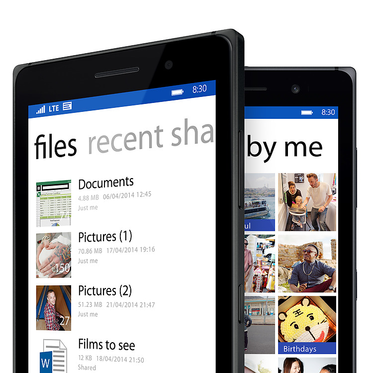 Two black Lumia 830 phones one with Onedrive file explorer screen and the other with the OneDrive photo album