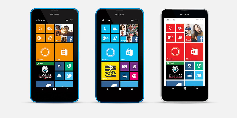 Three Lumia 635 phones with start screens