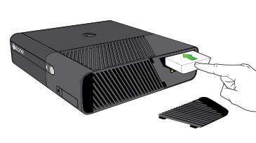 An illustration shows a hand inserting a hard drive into the hard drive slot on an Xbox 360 E console.