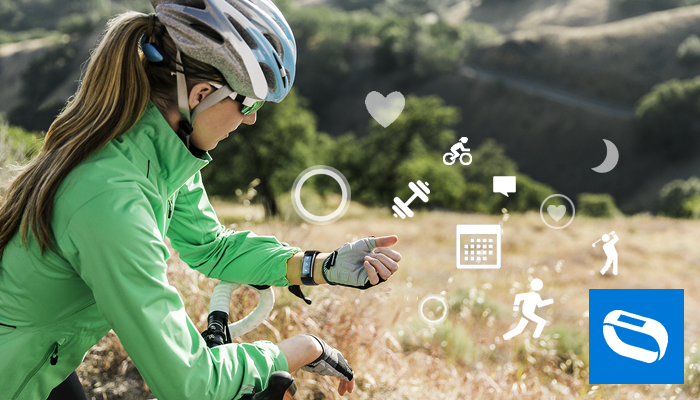 'Woman using Microsoft Band while biking' from the web at 'http://compass.xboxlive.com/assets/bc/d5/bcd598b4-c559-45e3-a204-f692e201c43b.png?n=microsoft-band-2-lifestyle-sensors-700.png'