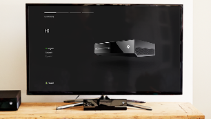 A TV shows Xbox One during the digital setup phase.