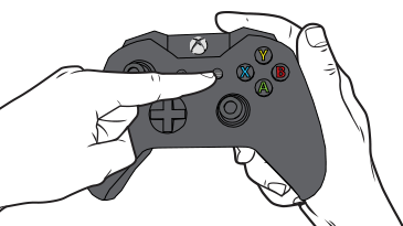 Un doigt appuie sur la touche Menu d'une manette XboxOne.