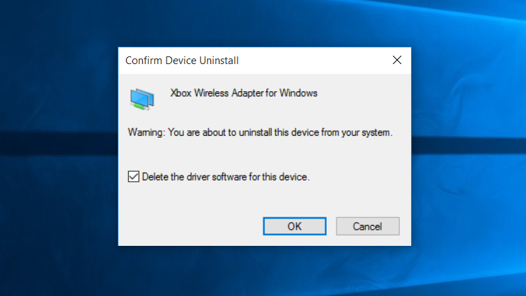 The confirmation window for 'Delete the driver software for this device', with the OK button highlighted