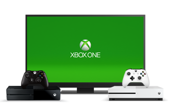 Xbox One consoles and controllers are pictured in front of a TV displaying the Xbox One logo.